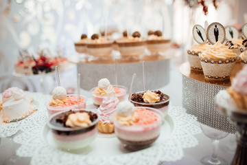 Poster Dairy products Candy bar. Table with different sweets for party. Sweet table for child birthday. Candy bar with a lot of different candies and sweet cakes