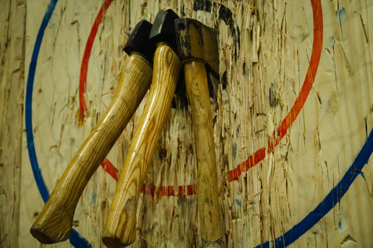 Axe stick on the bullseye target in Throwing axe new trend sport