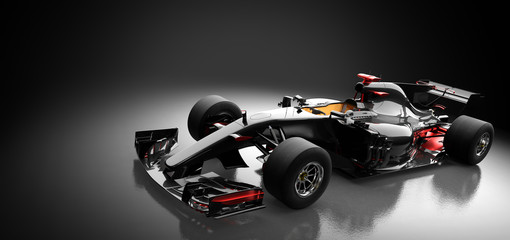 Modern race car in spotlight on black background.