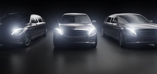 Luxurious cars, limousines in garage with lights turned on.