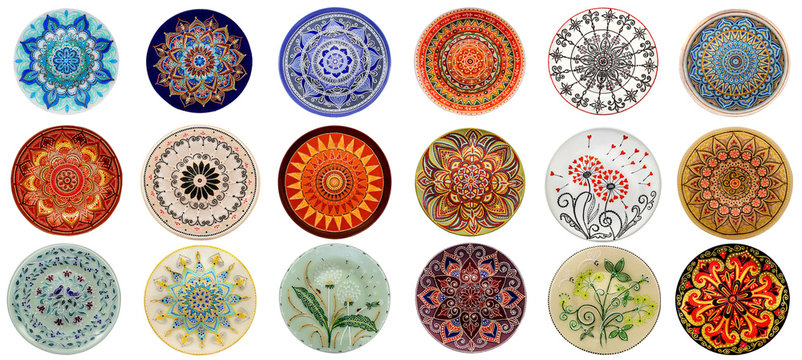 Set of decorative ceramic dishes hand-painted with acrylic paints floral pattern isolated on white background