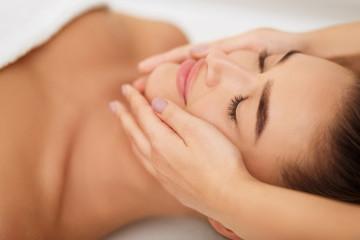 Woman getting face massage at beauty salon, closeup