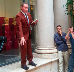 Actor Spacey reads a poem in front of the public in Rome