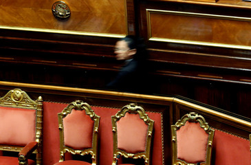 A Senate usher walks as the Italy's government is set to face Senate confidence vote