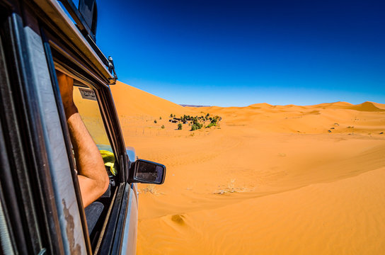 Off road car learning how to drive in sand dunes in Erg Chebbi, Morocco