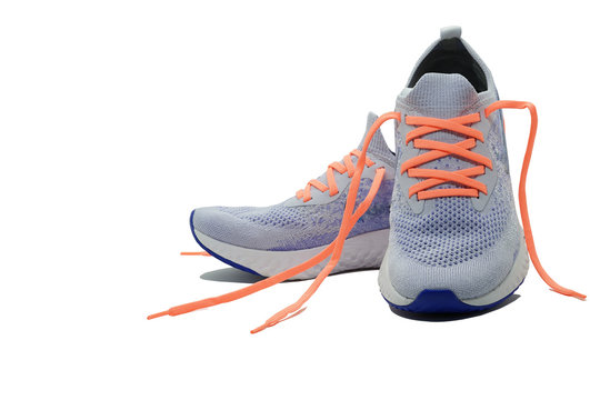 Shoelaceless running shoes on isolated white background with copy space