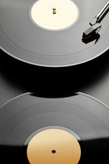 Two vinyl record on black background