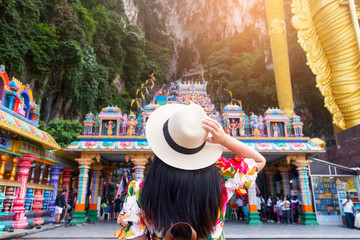 A woman tourist is sightseeing at Batu Caves in Kuala Lumpur, Malaysia.