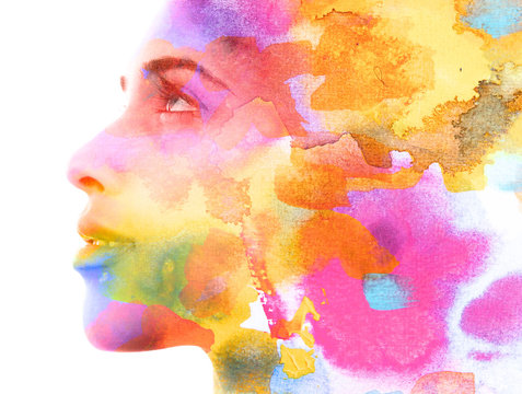 Paintography. Double exposure. Close up of an attractive model combined with colorful hand drawn ink and watercolor painting with overlapping brushstroke texture