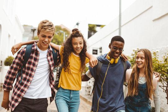 College friends walking in the street
