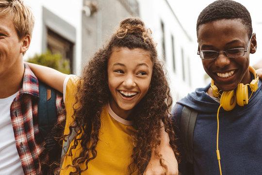 Cheerful teenage girl enjoying with friends