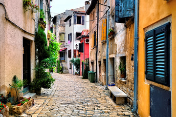 Fototapete - Colorful cobblestone street in the beautiful Old Town of Rovijn, Croatia