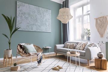 Obraz Boho interior design of living room with sofa and rattan armchair - fototapety do salonu