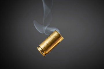 smoking bullet casing tumbling