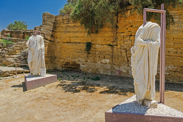 Headless Roman statues on display in archaeological site. Two torso marble statues exhibited at Valley of the Temples Park in Agrigento Sicily Italy.