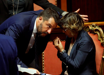 Deputy Prime Minister Salvini (L) and Italy's Minister Bongiorno gesture as Italy's government  is set to face Senate confidence vote on security and immigration decree in Rome
