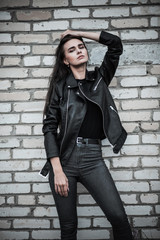Woman in a black leather jacket