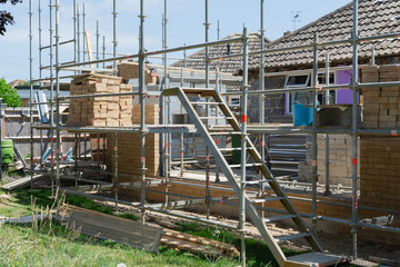 Renovation projects. Building of extension of the existing house, unfinished brick walls, block...