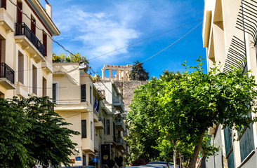 View of the Acropolis Hill among the streets in Athens.