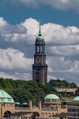 "Hamburg, Germany. The pier ""Landungsbruecken"" and the steeple of St. Michael's Church (St. Michaelis)."