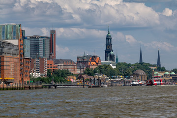 Hamburg Harbor, Germany. Cityscape with the pier Landungsbruecken and the church tower of St. Michael's Church (St. Michaelis).