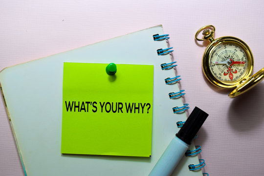 What's Your Why? text on sticky notes isolated on office desk