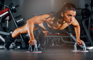 Fit Woman Doing Push Ups at the Gym