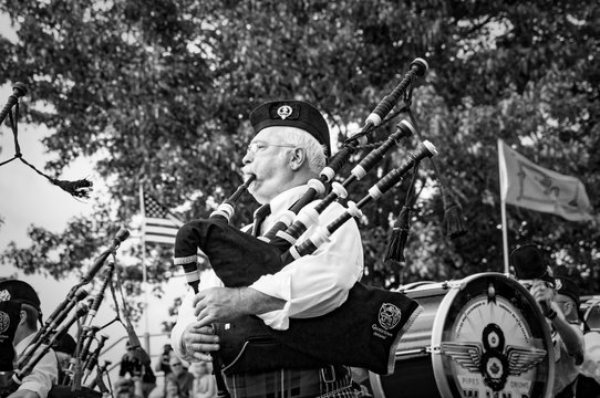 Fergus, Ontario, Canada - 08 11 2018: Pipers of the Pipes and Drums band paricipating in the Pipe Band contest held during Fergus Scottish Festival and Highland Games