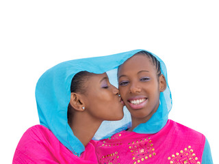 Two teenagers girls and a kiss on the cheek, isolated, white background