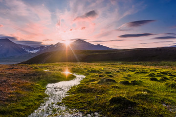 Zelfklevend Fotobehang Lichtroze Wallpaper norway landscape nature of the mountains of Spitsbergen Longyearbyen Svalbard on a flowers polar day with arctic summer in the sunset