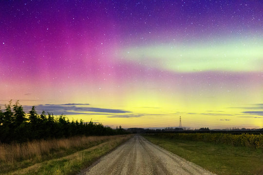 Aurora Australis, Southern Lights Night Sky Landscape With Stars Over Rural Road Near Christchurch, New Zealand
