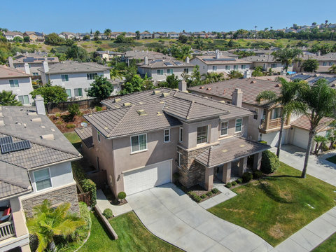 Suburban neighborhood street with big villas next to each other in Black Mountain, San Diego, California, USA. Aerial view of residential modern subdivision luxury house.