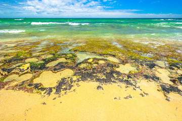 Mettams Pool a limestone bay safe for snorkelling place. Trigg Beach in North Beach near Perth, Western Australia. Mettam's is a natural rock pool protected by a surrounding reef.