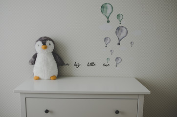 baby nursery with penguin toy