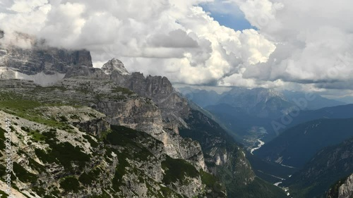 Wall mural Italian Dolomites and Auronzo Di Cadore in the Valley. Time-lapse Summer Scenery.