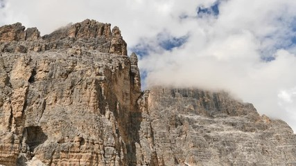 Fotomurales - Time Lapse of Clouds Covered Peaks of Cime di Lavaredo Mountain Range in Misurina, Italy.