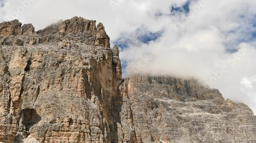 Wall mural Time Lapse of Clouds Covered Peaks of Cime di Lavaredo Mountain Range in Misurina, Italy.
