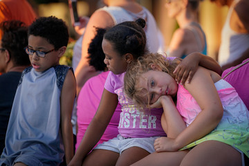 Childern gather for a memorial service honoring the victims of Dayton's mass shooting, in Springfield