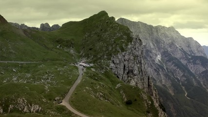 Wall Mural - Scenic Route to the Mangart Mountain in the Julian Alps. Northern Slovenia. Aerial Footage.