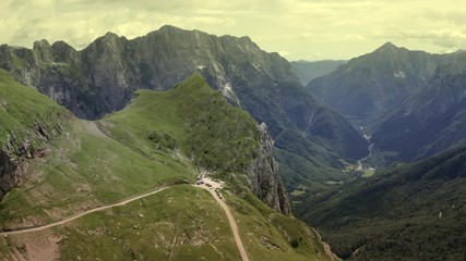 Wall Mural - Mangart Mountain Region in the Julian Alps of Slovenia, Europe. Aerial Scenic Footage.