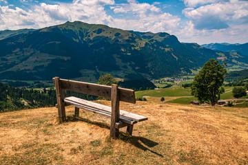 Beautiful alpine view with a bench at Aurach near Kitzbühel, Tyrol, Austria