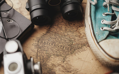 United States of America Map Between Traveler's Accessories on Old Vintage Map. Travel Concept Background.