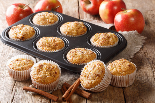 Vegetarian apple muffins with cinnamon close-up in a tray. horizontal