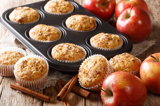 Sweet dessert apple muffins with cinnamon close-up in a baking dish. horizontal