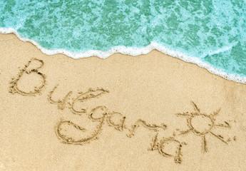 Bulgaria title on the light sand beach near the black sea coast.