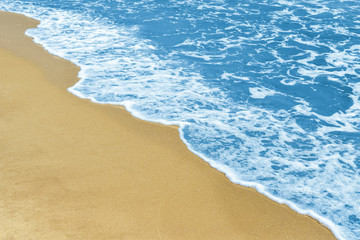Deep blue water and sandy beach. Beautiful coastline with copy space. Top view.