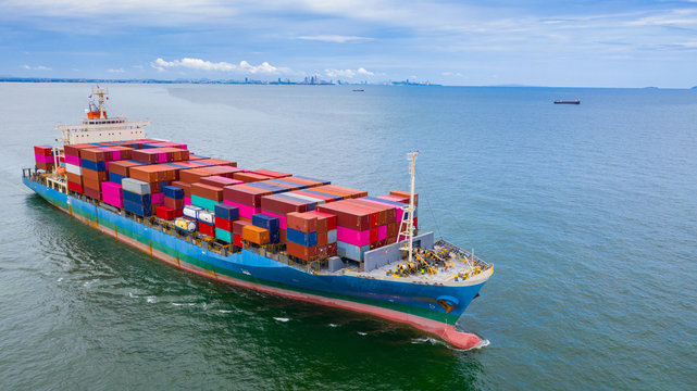 Aerial view container ship carrying container in import export business logistic and transportation of international by container ship in the open sea.