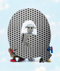Wall Mural - retro robots holding a big  metal letter Q with blue sky