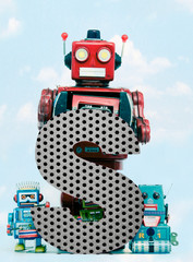 Fototapete - retro robots holding a big  metal letter  S with blue sky