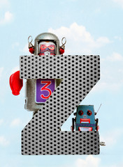 Wall Mural - retro robots holding a big  metal letter  Z with blue sky